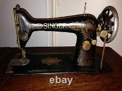 1916 Singer Sewing Machine MODEL 66, with a RED EYE decal design