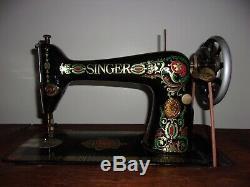 Antique 1913 Singer treadle sewing machine withOriginal Cabinet Red Eye Model 66-1