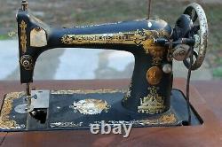 Antique Singer Sewing Machine In Treadle Oak Cabinet