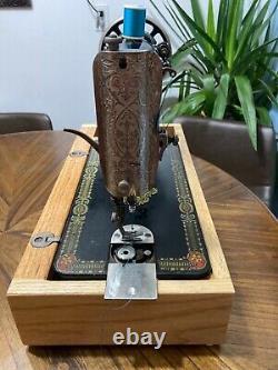 Antique Singer Sewing Machine Model 66 Hand Crank, 1919, Red Eye