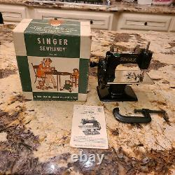 Antique Singer children's sewing machine with original box and instructions