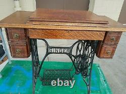 Antique early 1900's Singer Sewing Machine Lotus treadle cabinet withattachments