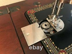 Antique singer sewing machine red eye