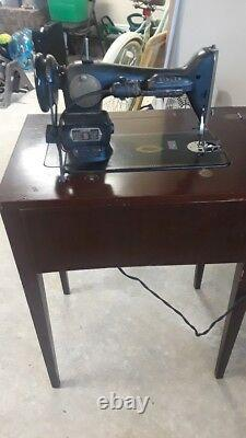 Antique singer sewing machine with table