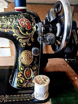 Astounding Antique Singer model 66 Red Eye sewing machine, back clamp atchm, 1915