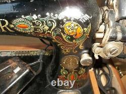 Singer sewing machine -1917 Red Eye Treadle Sewing Machine Model 66
