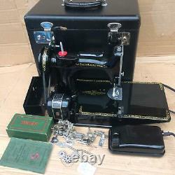 Vintage Singer 221K Featherweight Sewing Machine with attachments and manual